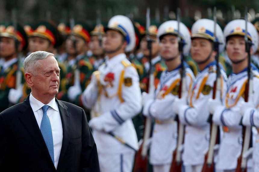 US Secretary of Defense Jim Mattis reviews the guard of honour during a welcoming ceremony in Hanoi, Vietnam on Jan 25, 2018.
