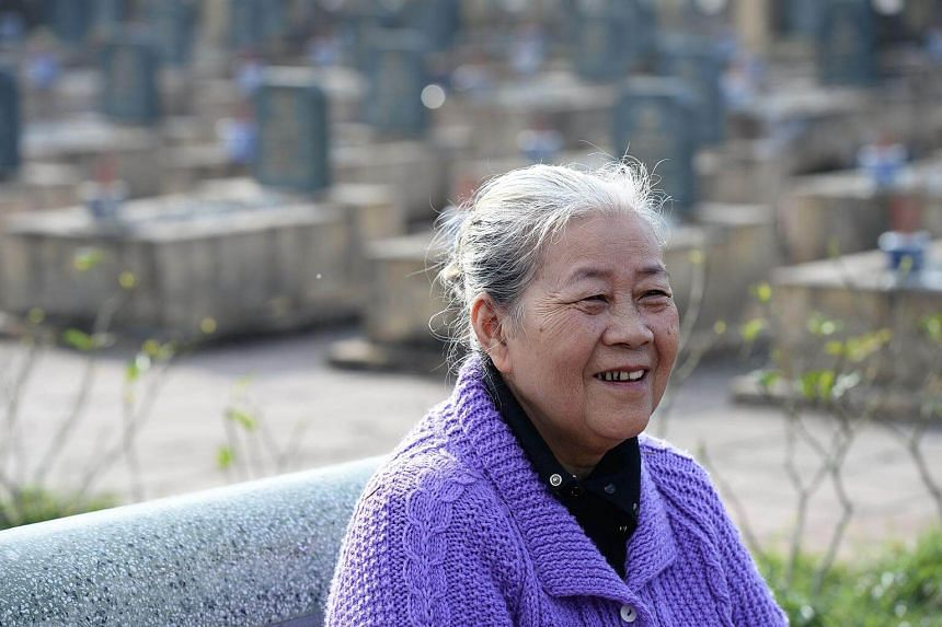 Nguyen Thi Hoa smiles during an interview at a cemetery on the outskirts of Hue, on Jan 17, 2018.