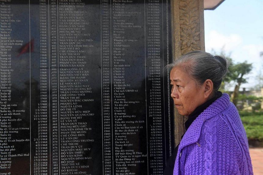 Nguyen Thi Hoa shows a photograph of herself taken in 1968 during an interview with AFP in the central city of Hue, on Jan 17, 2018.