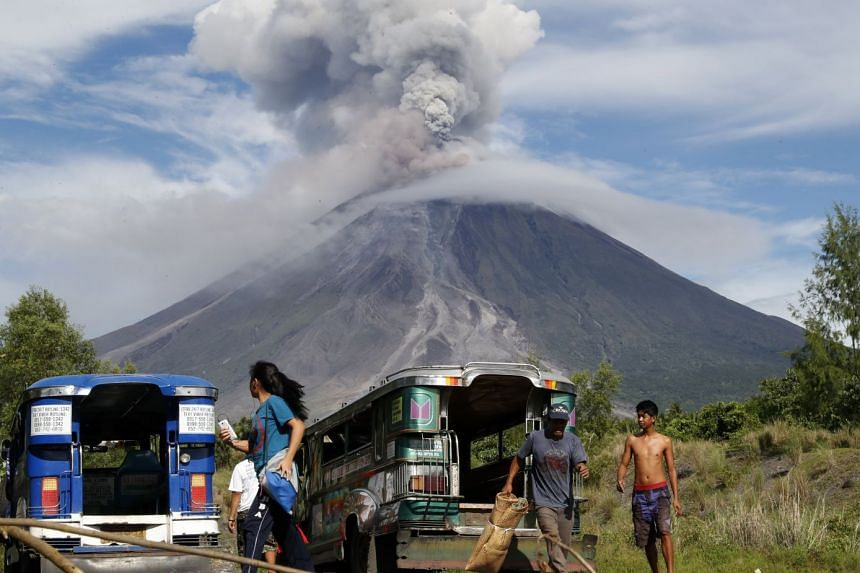 Residents fleeing after volcano Mount Mayon erupted again, in Legazpi city, Albay province, the Philippines, on Jan 25, 2018.