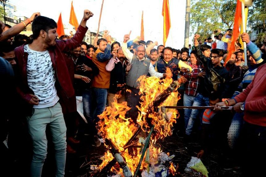 Indian Rajput community members protest and burn the effigy of Sanjay Leela Bhansali, the director of Bollywood movie Padmavat, in Bhopal, India, on Jan 24, 2018.