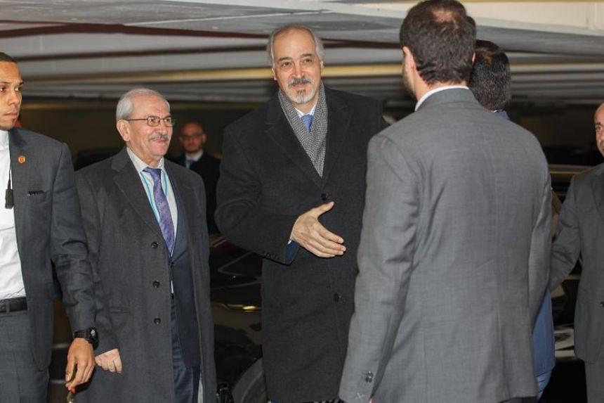 Syrian ambassador to the United Nations and head of the government delegation Bashar al-Jaafari (centre) arriving for a meeting with the UN Special Envoy for Syria in Vienna on Jan 25.