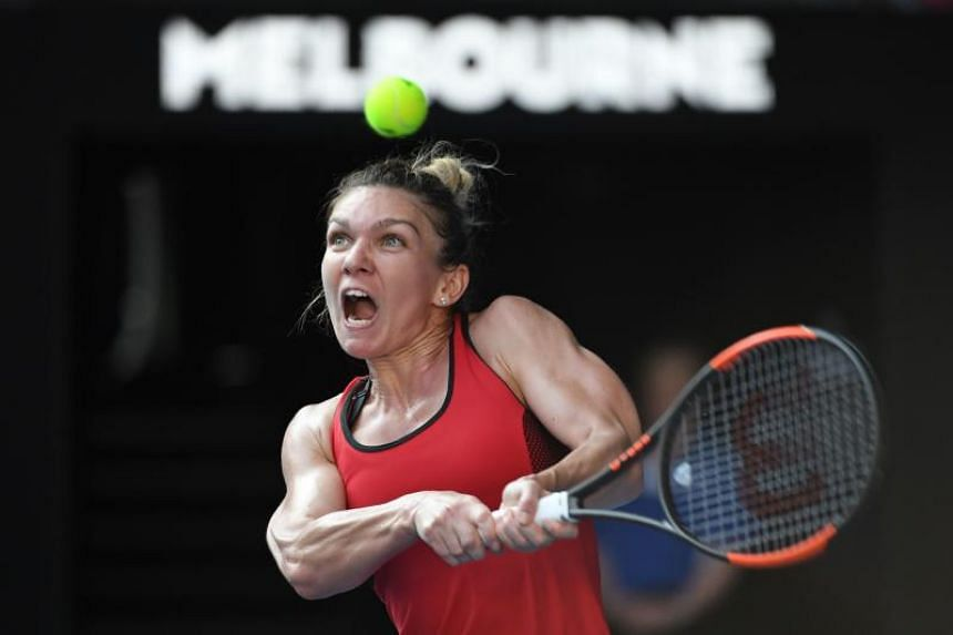 Romania's Simona Halep hits a return against Germany's Angelique Kerber during their women's singles semi-finals match on the eleventh day of the Australian Open in Melbourne on Jan 25, 2018.