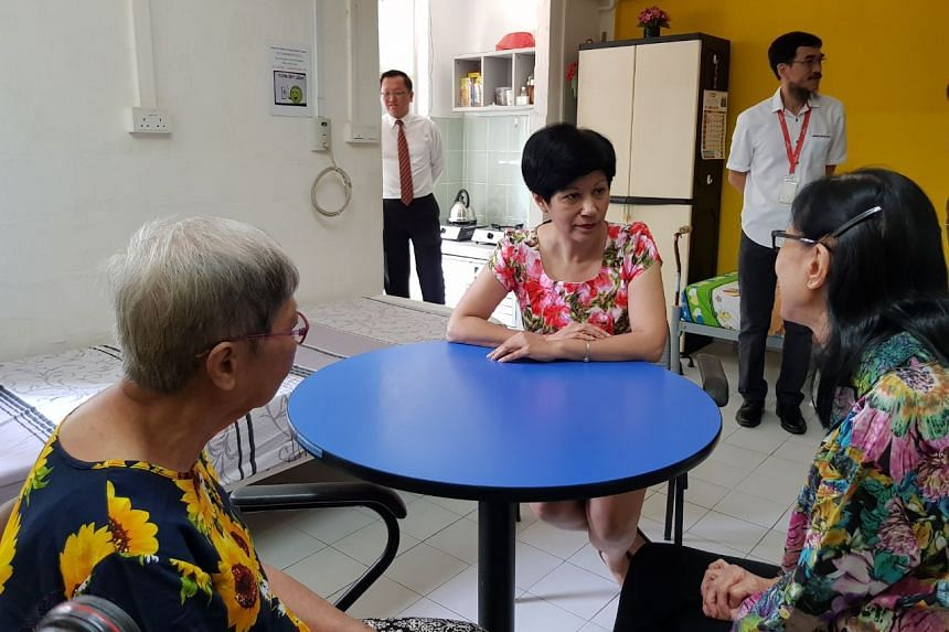 Ms Indranee Rajah with two seniors at the AWWA Senior Community Home in Ang Mo Kio.