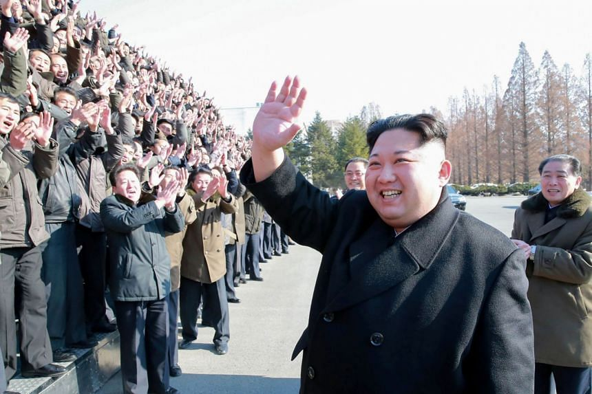 North Korean leader Kim Jong-Un (centre) visiting the State Academy of Sciences at an undisclosed location.