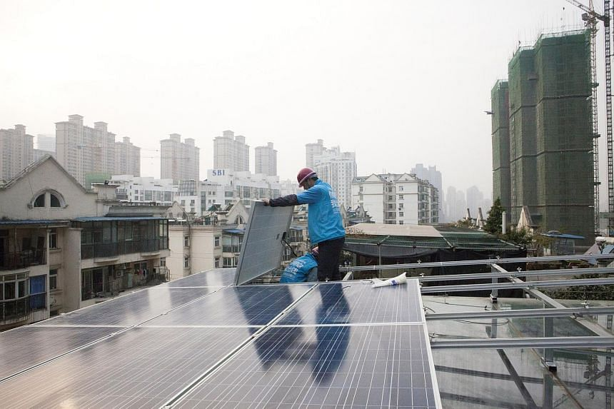 Solar panels are installed on a roof in Wuhan, China on Dec 3, 2016.