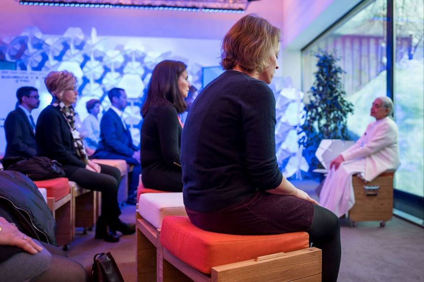 Participants attending the morning meditation session at the annual World Economic Forum in Davos, Switzerland, on Jan 24, 2018.