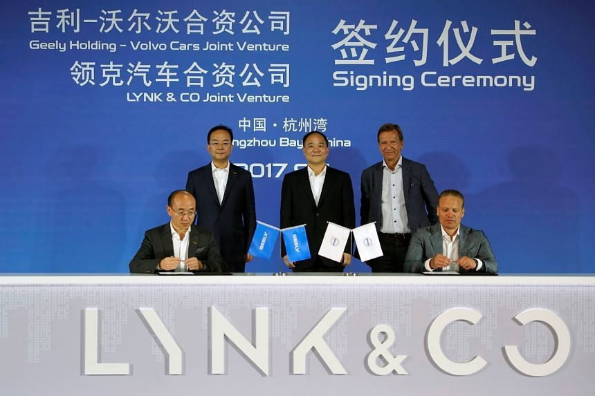 Li Shufu's (centre) Zhejiang Geely Holding Group started selling its upmarket compact SUV in China about two months ago under the Lynk & Co brand for a base price of 158,800 yuan (S$32,759).