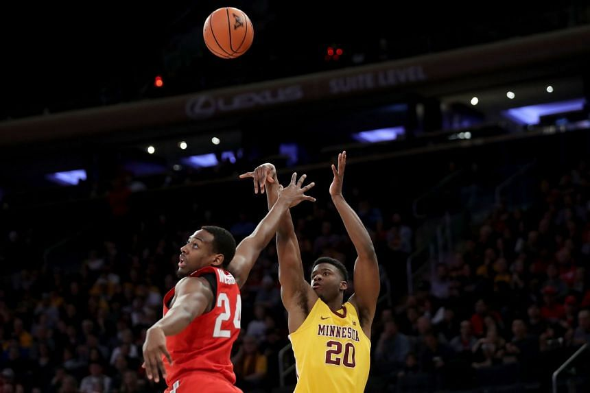 Davonte Fitzgerald of the Minnesota Golden Gophers takes a shot against Andre Wesson of the Ohio State Buckeyes in the first half during their game at Madison Square Garden on Jan 20, 2018 in New York City.
