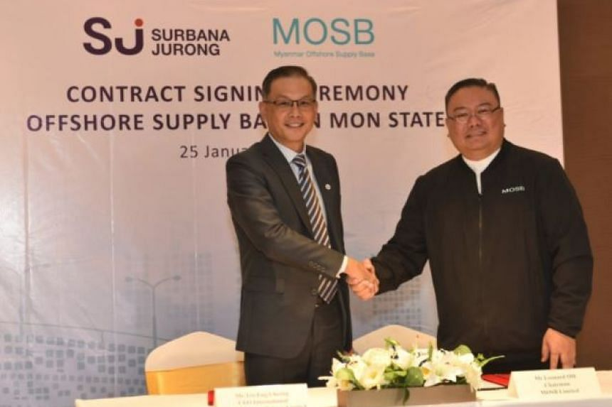 Surbana Jurong's Teo Eng Cheong (left) and MOSB's Leonard Oh after signing the agreement, on Jan 25, 2018.