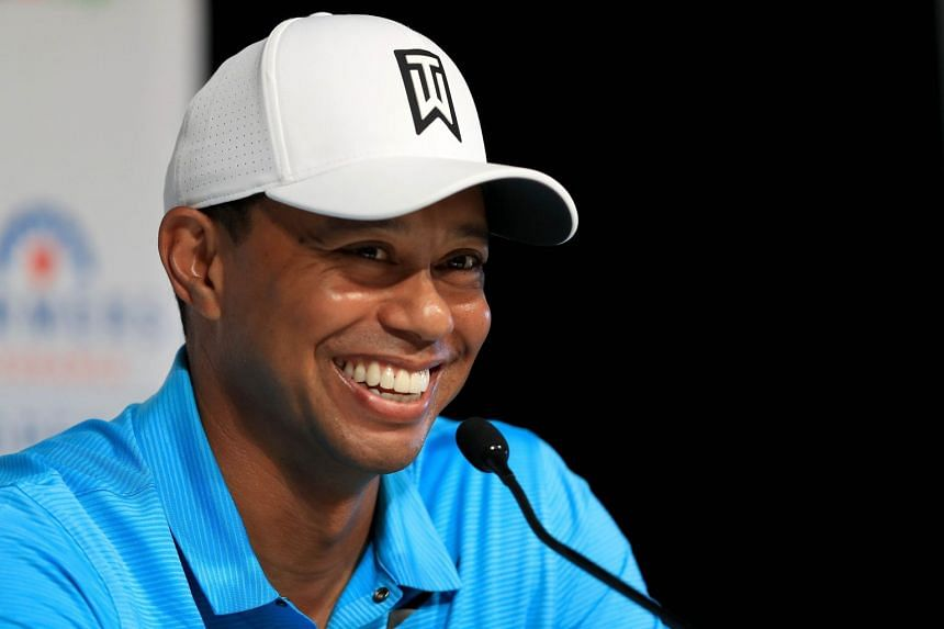 Tiger Woods laughs during a press conference after playing in the pro-am round.