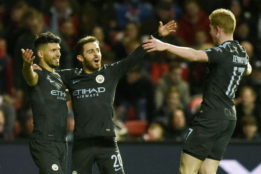 Manchester City's Sergio Aguero (left) celebrating his goal against Bristol City during their League Cup semi-final second leg with Bernardo Silva and the architect of the move, Kevin de Bruyne. City won 5-3 on aggregate.