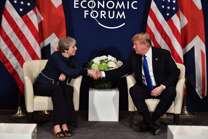 Trump and May shake hands during a bilateral meeting on the sidelines of the World Economic Forum.