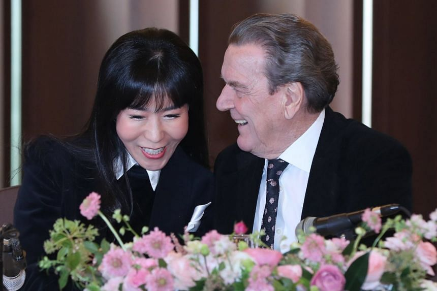 Former German Chancellor Gerhard Schroeder and his South Korean fiancee Kim So Yeon at a news conference at the Korea Press Centre in Seoul on Jan 25, 2018.