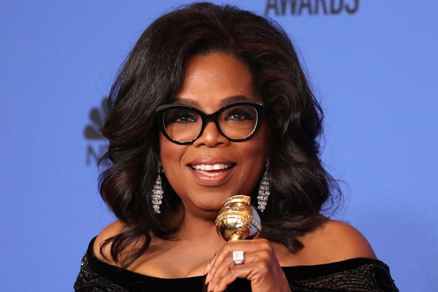 Oprah Winfrey poses backstage at the Golden Globe awards with her Cecil B. DeMille honour.