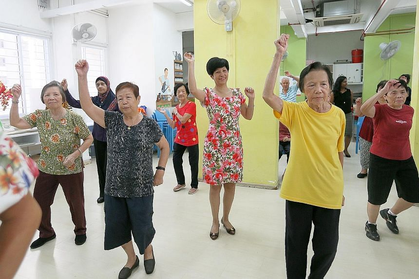 Ms Indranee Rajah (second from right) dancing with some seniors at the Awwa Dementia Day Care Centre yesterday.