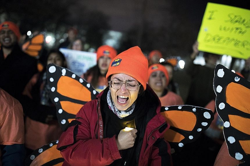Demonstrators at a rally in Washington on Sunday to show support for the Obama-era programme called Deferred Action for Childhood Arrivals, which expires in March.