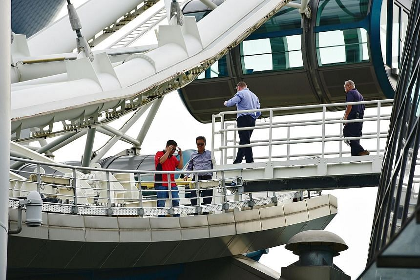Staff at the Singapore Flyer yesterday after a technical issue at about 9am forced rides to be suspended at the tourist attraction. A notice (above, left) was put up informing people of the temporary closure. In a Facebook post, the Flyer said it wou