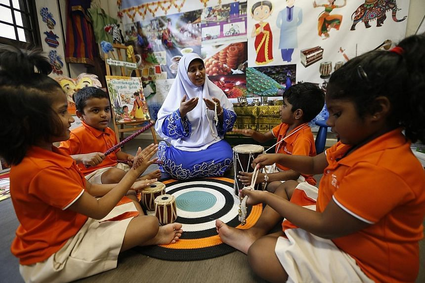 Tamil language teacher Aisha Banu, 47, with a class of pre-schoolers at the My First Skool centre in Yishun. NTUC First Campus started offering Malay at 22 My First Skool centres in 2015, and Tamil at two centres in 2016, and plans to have more centr