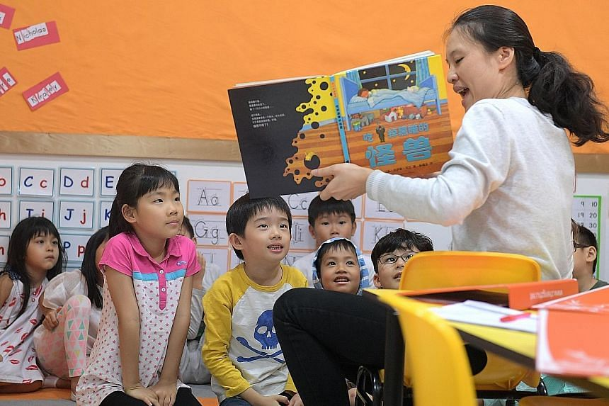 Ms Fang Ping, a Singapore citizen originally from China and the head of Chengzhu Mandarin Centre, teaching a creative writing class at the centre, which comes under Julia Gabriel Education.
