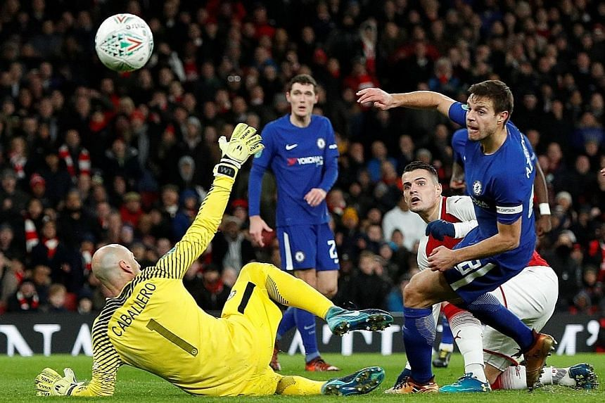Granit Xhaka scoring Arsenal's second goal against Chelsea to complete their comeback in the League Cup semi-final second leg at the Emirates Stadium. The Gunners will play Manchester City in the final at Wembley on Feb 25.