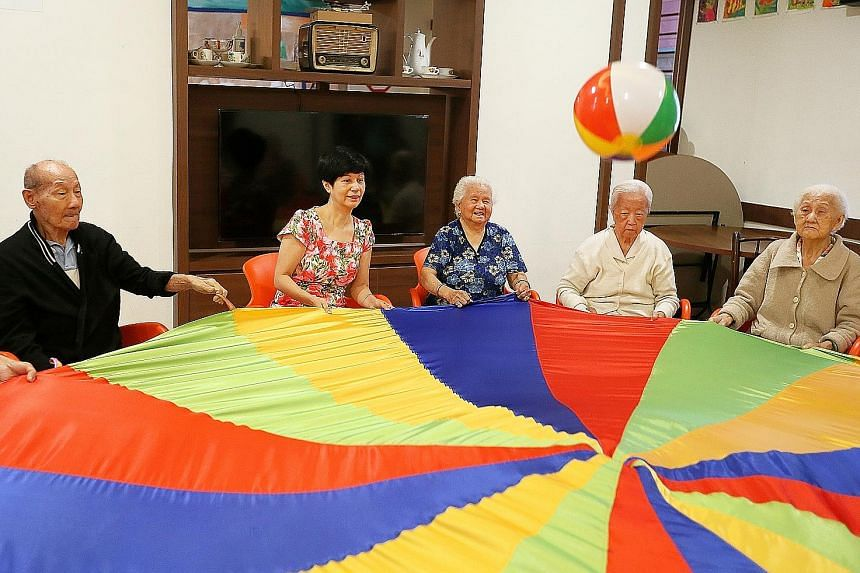 Senior Minister of State for Finance Indranee Rajah joining seniors in an activity at the Awwa Dementia Day Care Centre yesterday.