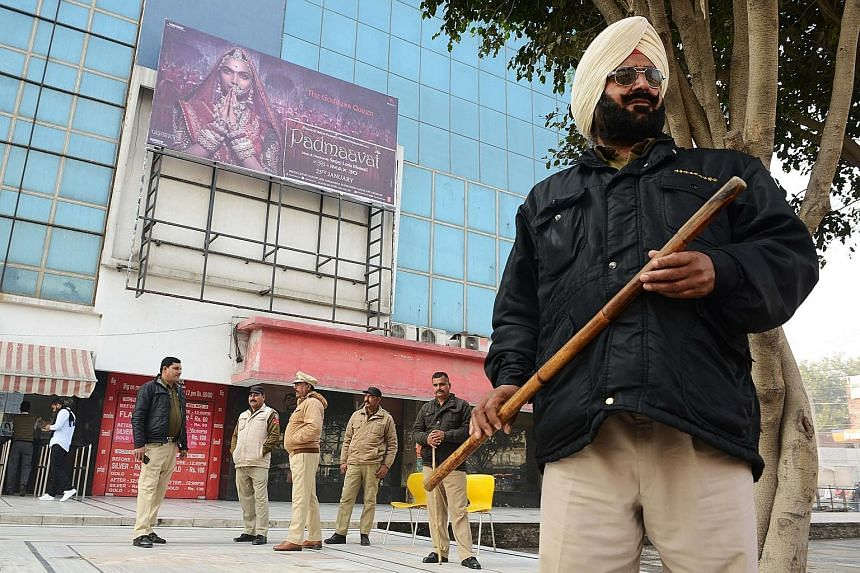 Policemen in Amritsar, Punjab, standing guard yesterday outside the Suraj Chand Tara cinema hall, which is scheduled to screen Padmaavat.