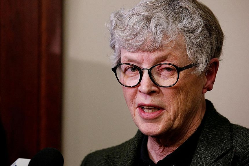 """Ms Lou Anna Simon, who has quit as Michigan State University president, denied a """"cover-up"""" over the Nassar case."""