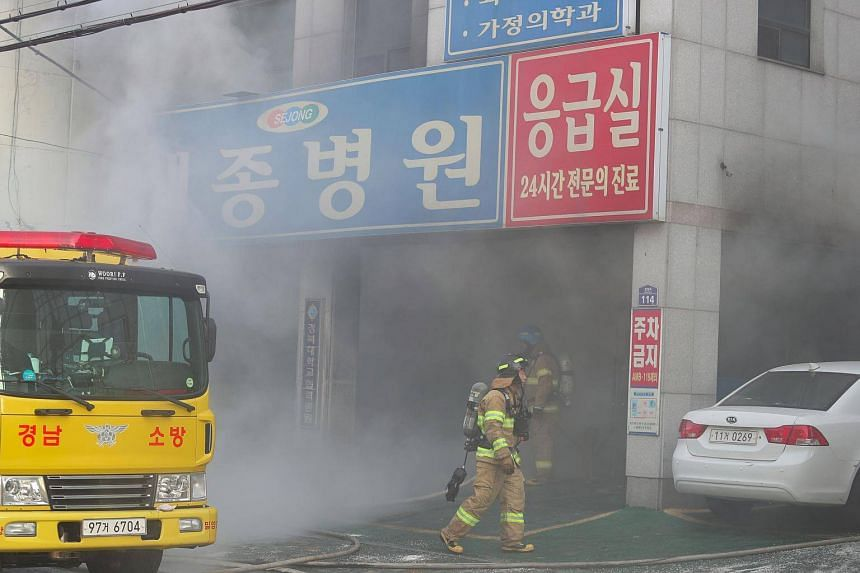 Firefighters try to put out a fire at Sejong Hospital in Miryang, South Korea, on Jan 26, 2018.