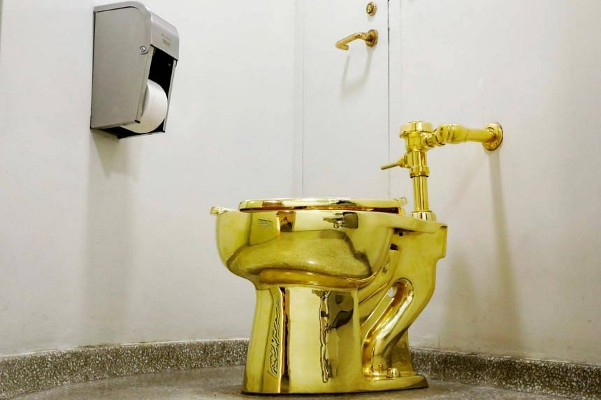 Maurizio Cattelan's America, a fully functional solid gold toilet, is seen at The Guggenheim Museum in New York City, on Aug 30, 2017.