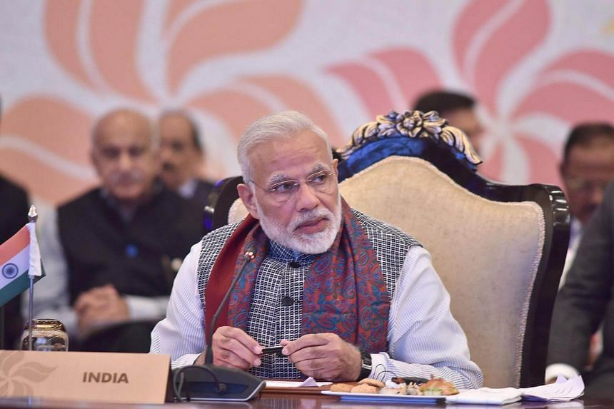 Indian Prime Minister Narendra Modi (centre) speaks during the Asean-India Commemorative Summit 2018 in New Delhi, India.