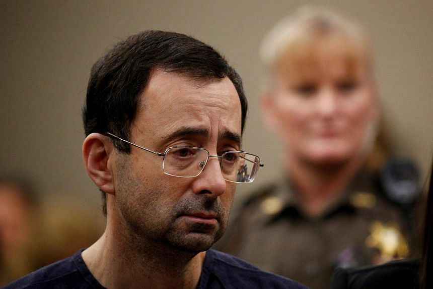 Lawrence Nassar, stands with his legal team during his sentencing hearing in Lansing, Michigan, on Jan 24, 2018.
