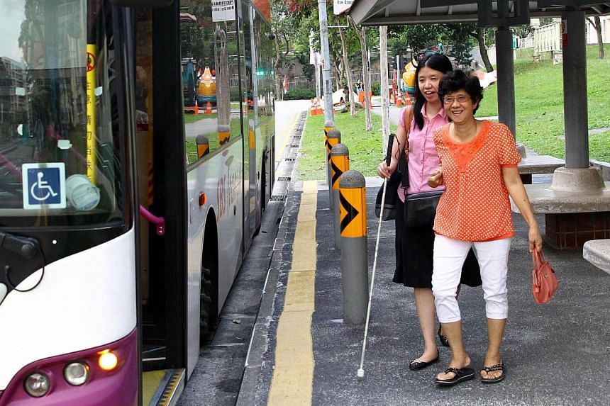 Research scientist Yeo Sze Ling, who is visually handicapped, is accompanied by her mother to the bus stop every day as she makes her way to work.