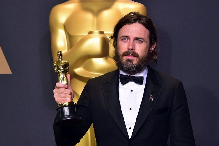 Affleck with his 2017 Best Actor Oscar for the movie Manchester By The Sea.