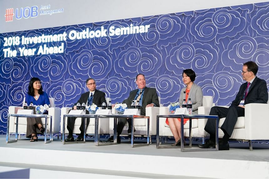 """From left to right: Ms Lorna Tan, Invest Editor, The Straits Times, moderated the panel discussion on """"Planning for Retirement in Ageing Asia,"""" joined by panellists Mr Suan Teck Kin, Head of Global Economics and Markets Research, UOB; Mr John Doy"""