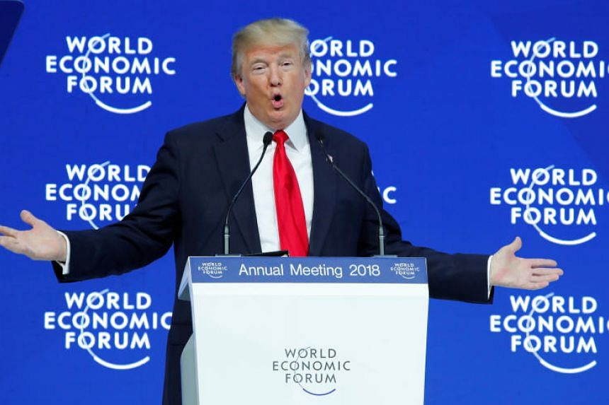 US President Donald Trump gestures as he delivers a speech during the World Economic Forum annual meeting in Davos, Switzerland on Jan 26, 2018.
