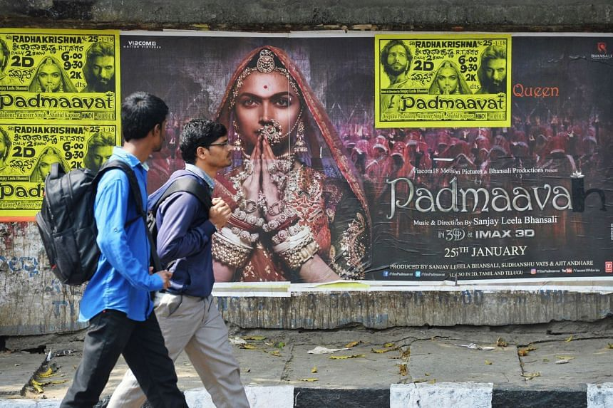 Pedestrians walk past a poster of controversial film Padmaavat in Bangalore on Jan 25, 2018.