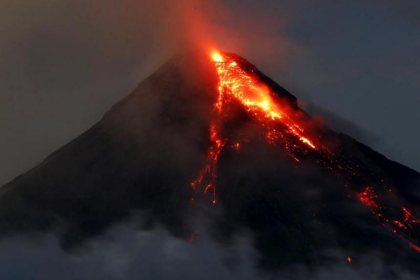 The Mayon volcano spews ash and lava in the town of Daraga, Albay province, Philippines, on Jan 25.