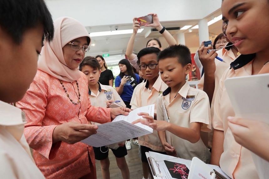 President Halimah Yacob with students from Loyang Primary School at the Istana Heritage Gallery (IHG) for the inaugural IHG Challenge on Jan 26, 2018.