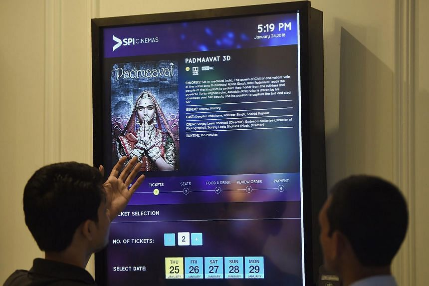 India cinema hall workers adjust a ticket machine ahead of a scheduled showing of Bollywood film Padmaavat in Mumbai, on Jan 24, 2018.