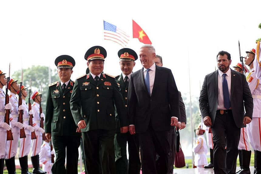 US Secretary of Defence James Mattis and Vietnam's Defence Minister Ngo Xuan Lich at a welcoming ceremony in Hanoi on Jan 25.