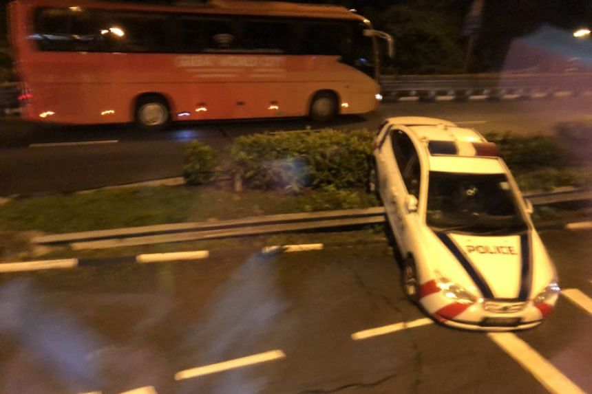 Photos circulating on social media show the police car stuck over the road divider.