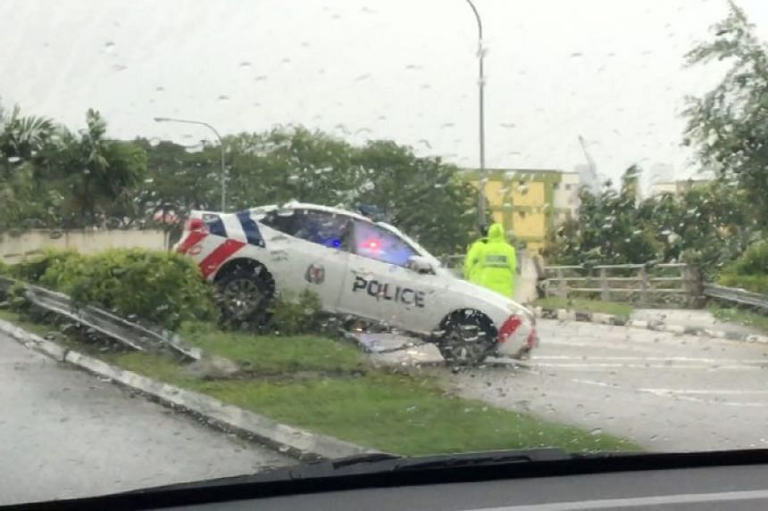 Photos circulating on social media show the car stuck over the road divider.