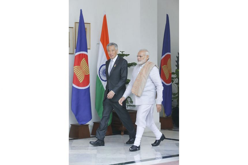 Prime Minister Lee Hsien Loong and his Indian counterpart, Mr Narendra Modi, on their way to a meeting in New Delhi yesterday. As Asean chair, Singapore is committed to deepening Asean-India ties, says PM Lee.