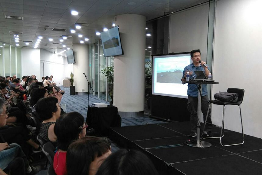 """The Straits Times' deputy tech editor Trevor Tan at an askST@NLB talk titled """"Is your smartphone's camera good enough?"""" on Jan 26."""
