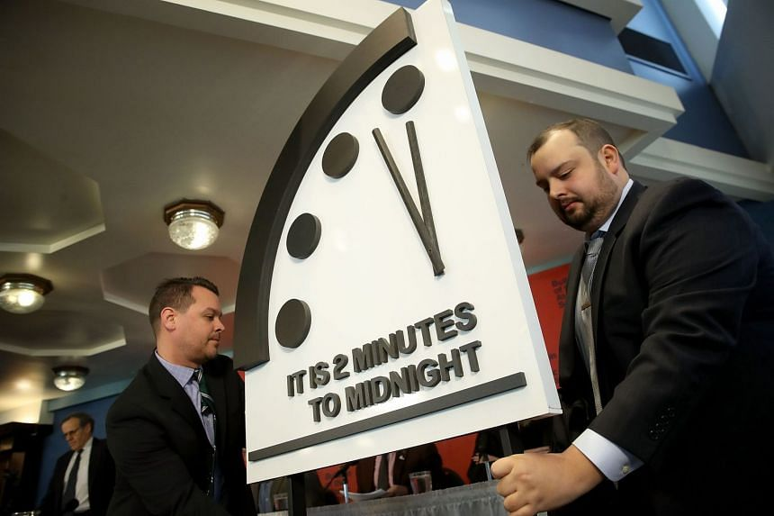 "The symbolic ""Doomsday Clock"" (above) has been pushed to two minutes before midnight."