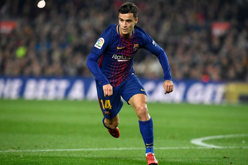 Barcelona's Brazilian midfielder Philippe Coutinho runs during the Spanish Copa del Rey quarter-final second leg football match between FC Barcelona and RCD Espanyol at the Camp Nou stadium in Barcelona on Jan 25, 2018.