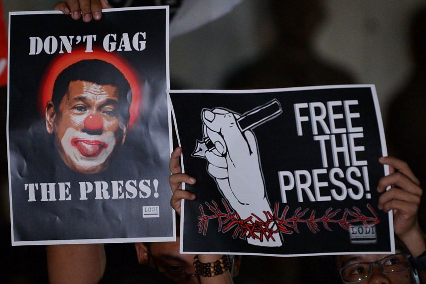 Protesters in support of Rappler, a news website facing state-enforced closure, gather in Manila on Jan 19.
