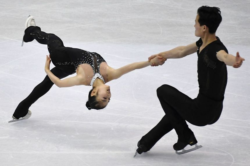 Ryom Tae Ok (left) and Kim Ju Sik of North Korea perform during the pairs free skating program at the ISU Four Continents figure skating championships in Taipei on Jan 26, 2018.