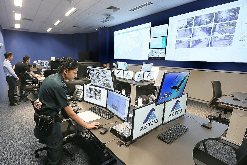 Second Minister for Home Affairs Josephine Teo said the use of technology to carry out routine, labour-intensive tasks allows security officers to focus on tasks that are more complex or require human judgment. Right: The command centre at the new Ae